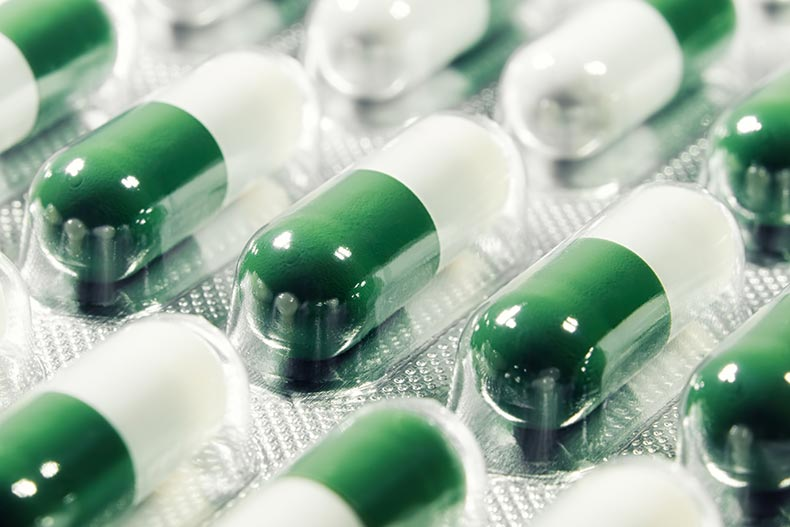 Vacuum formed blister packs with green and white pills