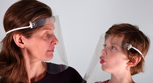 Woman and boy wearing VisorProtect Face Shields